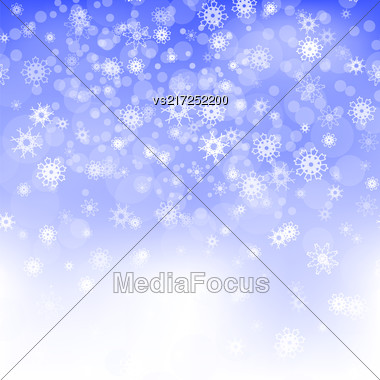 Show Flakes Pattern On Blue Sky Background. Winter Christmas Natural Blurred Texture Stock Photo
