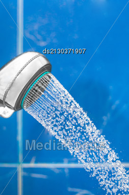 Shower Head With Water Drops Fallind Down From In Bathroom On Blue Background Closeup Shot Spa Concept Stock Photo