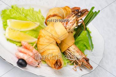Shrimps, With Lettuce, Green Onion, Lemon And Black Olive Stock Photo