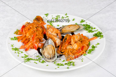 Shrimps Mussels And Squid Tasty Seafood Dish Stock Photo