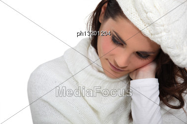 Shy Woman Wearing Hat And Jumper Stock Photo