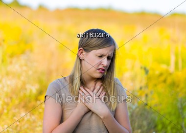 Sick Woman With Asthmatic Allergy Symptom Because Of Rapseed On The Field Stock Photo