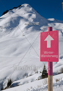 Sign Winter Hiking In Snowy Mountains Stock Photo