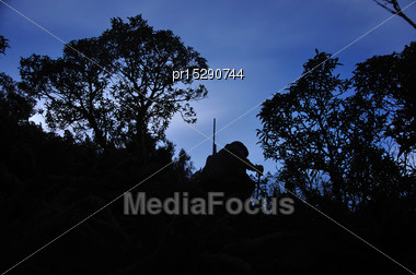 Silhouette Of Hunter In South Westland's Southern Alps, New Zealand Stock Photo