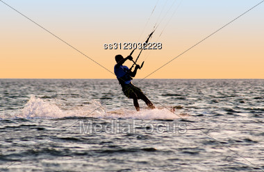 Silhouette Of A Kitesurfer On Waves Of A Gulf Stock Photo