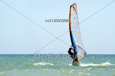 Silhouette Of A Windsurfer On The Sea Surface Stock Photo