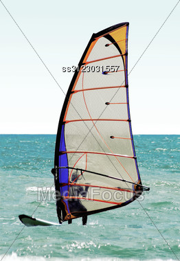 Silhouette Of A Windsurfer On The Sea Stock Photo