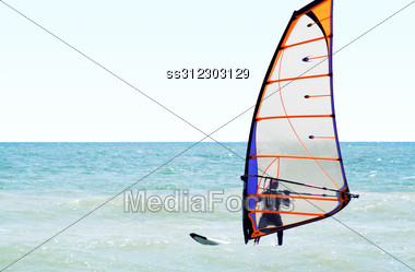 Silhouette Of A Windsurfer On The Sea In The Afternoon Stock Photo