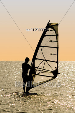 Silhouette Of A Windsurfer On Waves Of A Gulf Stock Photo