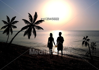 Silhouettes Happy Enamoured Going On A Beach Stock Photo