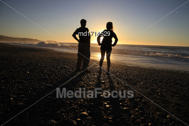 Sillouette People And Beach New Zealand South Island Stock Photo