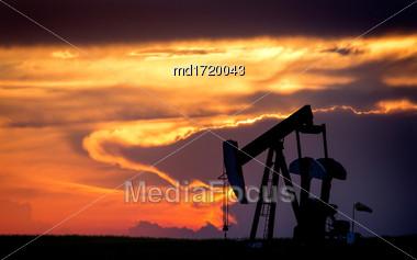 Sillouette Sunset Saskatchewan Orange Color Oil Jack Stock Photo