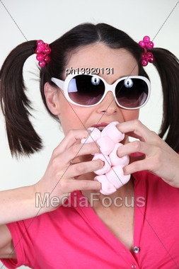 Silly Woman Scarfing Down Marshmallows Stock Photo
