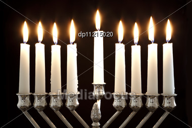 Silver Hanukkah Candles All Candle Lite On The Traditional Hanukkah Menorah Stock Photo