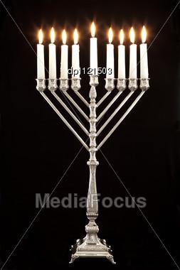 Silver Hanukkah Candles All Candle Lite On The Traditional Hanukkah Menorah Stock Photo