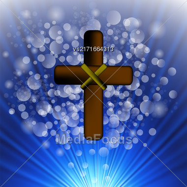 Simple Brown Wooden Cross On Blue Blurred Background Stock Photo