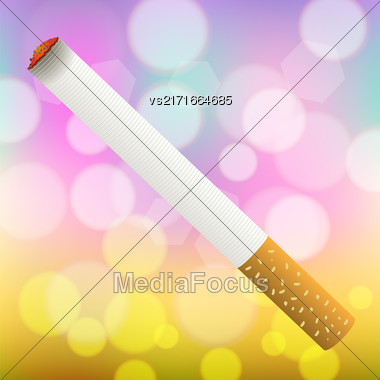 Single Cigarette Isolated On Colorful Blurred Background. Health Care Concept Stock Photo