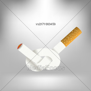 Single Cigarette Knotted And Isolated On Gray Soft Background. Health Care Concept Stock Photo