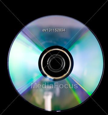 Single DVD-RW Disc On Black Background Stock Photo