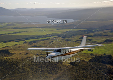 Single Engined Light Aircraft Flying Over Westland, New Zealand Stock Photo
