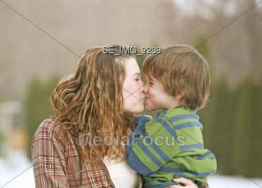 Sister Brother Kissing Stock Photo