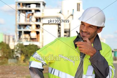 Site Foreman Communicating Via Radio Receiver Stock Photo