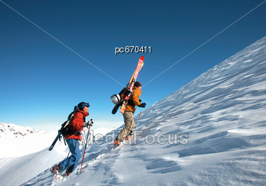 Ski Mountaineers During Ascent Stock Photo