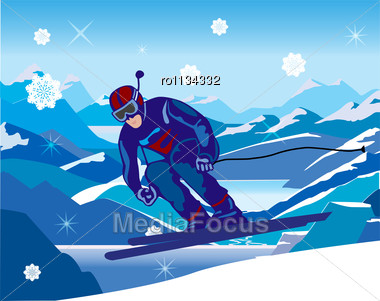 Skier Sloping Down From The Hill Stock Photo