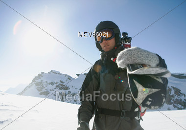 Skier With Skis On His Shoulder Stock Photo