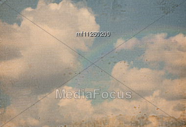 Sky Cloudy Background With Rainbow. Retro Style Stock Photo