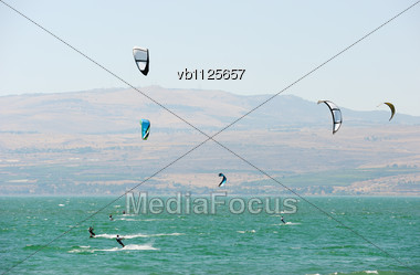 Sky-surfing In The Rays Of The Setting Sun On Lake Kinneret Stock Photo