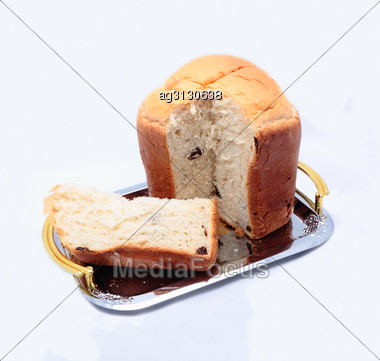 Slice Of White Bread Next To A Round Loaf. Isolated Stock Photo