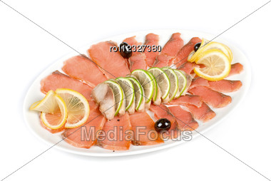 Sliced Chum Salmon And Mackerel Decorated With Limes, Lemons And Olives Isolated On White Stock Photo
