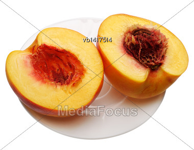 Sliced Peach On A White Plate, Isolated On A White Background Stock Photo