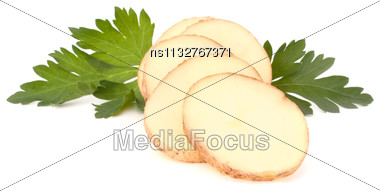 Sliced Potato Tubers And Parsley Leaves Isolated On White Background Cutout Stock Photo