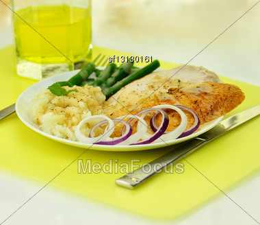 Sliced Turkey With Mashed Potatoes And Green Beans Stock Photo
