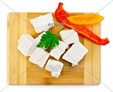 Slices Of Brine Cheese, Parsley, Slices Of Red And Yellow Sweet Peppers On A Wooden Board Stock Photo