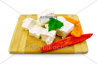 Slices Of Feta, Parsley, Slices Of Red And Yellow Sweet Peppers On A Small Wooden Board Stock Photo