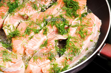 Slices Of Fried Trout With Dill In A Pan Stock Photo