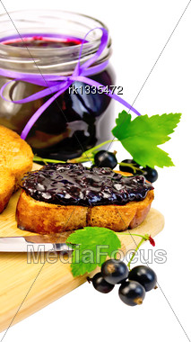 Slices Of Toasted Bread, A Glass Jar With Black Currant Jam On The Board Isolated On White Background Stock Photo