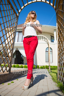Slim Blond Woman Wearing White Top And Red Panties Posing In Archway Outdoors Stock Photo