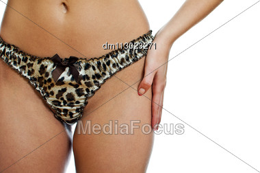 Slim Woman Body In Leopard Panties. Isolated On White Background. Stock Photo