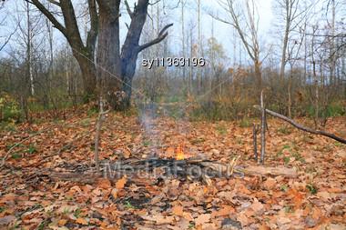 Small Campfire Amongst Yellow Sheet Stock Photo