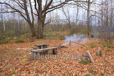 Small Campfire Amongst Yellow Sheet Stock Photo