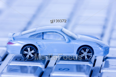 Small Car On The Computer Keyboard Stock Photo