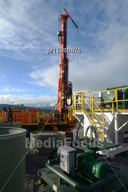 Small Drilling Rig Set Up With Mud Tanks And Pumps Stock Photo
