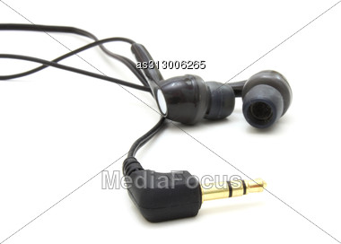 Small Ear-phones And The Tip For Connection Stock Photo