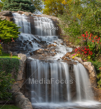 Small Waterfall At The Rivers Bank Stock Photo