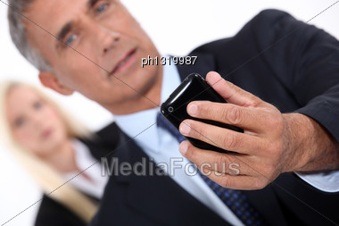 Smart Man Taking Picture With Mobile Phone Stock Photo