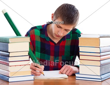 Smart scholar writing homework with big pencil. Stock Photo